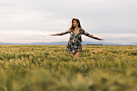 Woman dancing on a field - JPF000147