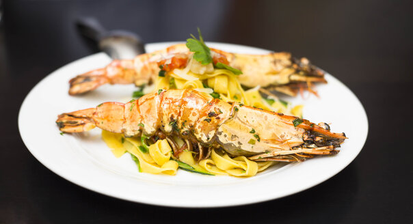 Spiny lobster on fresh pasta on plate - FCF000934