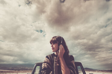 Young woman on the road listening music with headphones - SIPF000473