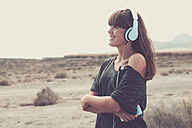 Young woman listening music, smiling happily - SIPF000488