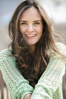 Portrait of smiling young woman with long brown hair - GDF000988