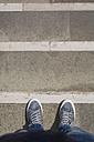 Man's feet on stone floor - MAUF000587