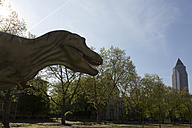 Germany, Frankfurt, dinosaur at Senckenberg Museum with Messeturm in background - FC000941