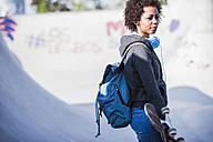 Young woman with skateboard - UUF007240