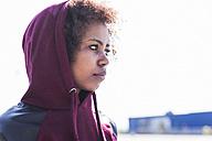 Young woman wearing hoodie outdoors - UUF007300