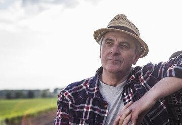 Portrait of a farmer wearing straw hat - UUF007347
