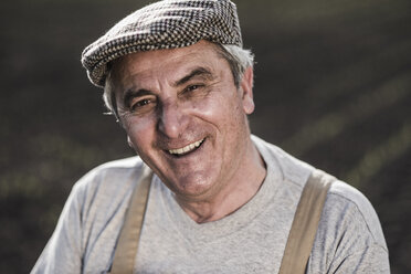 Portrait of smiling farmer at a field - UUF007353