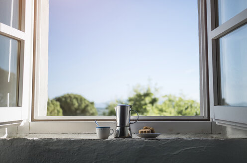 Espresso can, coffee cup and pastry by the window - RIBF000413