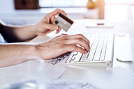 Man making online payment with credit card - HAPF000421