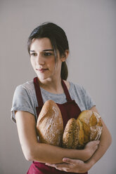 Woman holding different home made breads - EBSF001400