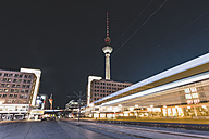 Germany, Berlin, Alexanderplatz and TV Tower at night, light trail of tramway - ZMF000475