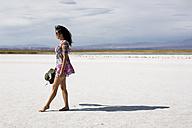 Chile, San Pedro de Atacama, woman walking in the desert - MAUF000600
