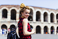 Italy, Verona, smiling woman in front of Verona Arena - GIOF001054