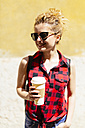 Smiling young woman with coffee to go - GIOF001060
