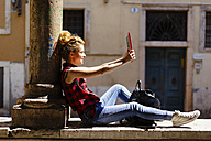Italy, Verona, woman taking selfie with digital tablet - GIOF001069