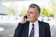Senior businessman on cell phone - DIGF000530