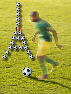 Soccer player and Eiffel Tower made of soccer balls, composite - BSC000529