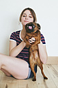 Young woman with her dog - RTBF000214