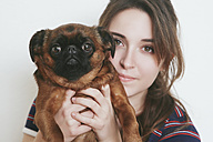 Portrait of young woman and her dog - RTBF000217