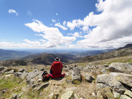 Spain, Sierra de Gredos, hiker sitting in mountainscape - LAF001642
