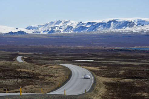 Iceland, road with car and mountains in the background - FDF000161