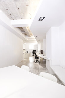 Modern office with meeting table in the foreground - MFRF000651