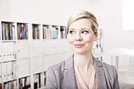 Portrait of blond businesswoman in the office - MFRF000699