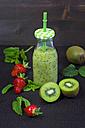 Glass bottle of kiwi lime smoothie - YFF000544