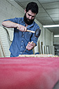 Carpenter using a chisel and hammer - ABZF000588