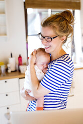 Happy mother with baby at home - HAPF000470