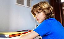 Portrait of pensive boy doing homework - MGOF001917