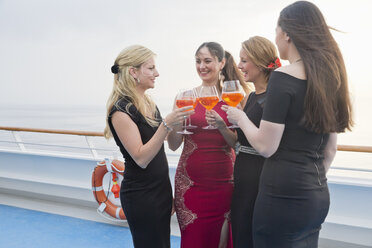 Four women toasting with aperitive on a cruise liner - ONBF000025