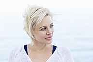 Portrait of blond woman in front of the sea - ONBF000030