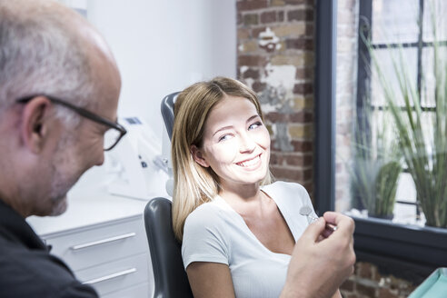 Young woman consulting dentist - FMKF002629