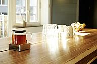 Teapot on teapot warmer on tabletop in a modern office - TSFF000017