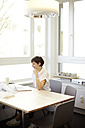 Architect using laptop in her office - TSFF000047