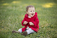 Baby girl sitting on a meadow - LITF000369