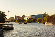 Germany, Berlin, modern buildings at Spree riverside and television tower in the background - TAMF000498