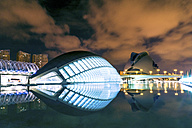 Spain, Valencia, lighted L'Hemisferic and Palau de les Arts Reina Sofia at City of Arts and Sciences by night - PUF000514