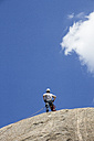 Climber standing on the top of a rock - ABZF000612