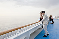 Four people with aperitive on deck of a cruise liner - ONBF000039