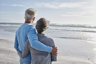 Back view of couple on the beach looking to the sea - RORF000212