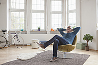 Relaxed mature man at home sitting in chair - RBF004535