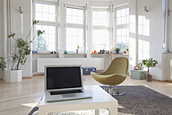 Home interior with laptop and chair - RBF004550