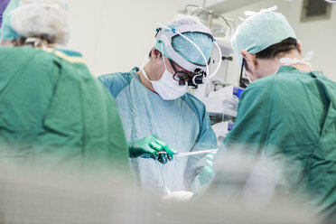 Heart surgeons and operating room nurse during an operation - MWEF000059