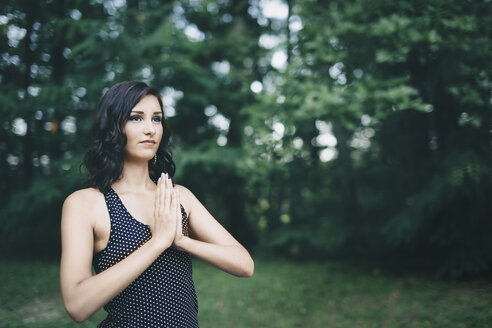 Young woman meditating in the forest, yoga in nature - LCU000008