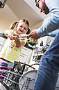 Daughter helping father clearing dishwasher - UUF007448