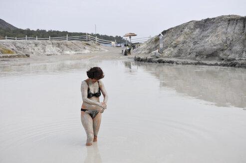 Italy, Vulcano, mudbathing woman - HWOF000105