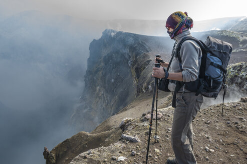 Italy, Sicily, Mount Etna, tourist looking in crater - HWOF000114