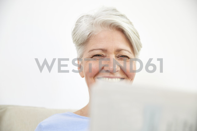 Portrait of smiling woman with laptop - FMKF002727
